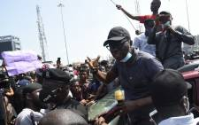 Lagos State Governor Babajide Sanwo-Olu (2nd R) speaks to protesters campaigning against abuses by the Special Anti-Robbery Squad (SARS) at the Lekki toll Plaza in Lagos, on 12 October 2020. Picture: AFP