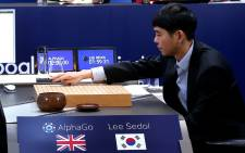 A picture provided by Google DeepMind on 12 March, 2016, Lee Se-Dol, one of the greatest modern players of the ancient board game Go, makes a move during the third game of the Google DeepMind Challenge Match against Google-developed supercomputer AlphaGo at a hotel in Seoul on 12 March, 2016. Picture: AFP.