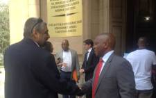 Nkosinathi Biko and Imtiaz Cajee at the High Court in Johannesburg after successfully interdicting an auction that looked to sell the autopsy reports of Steve Biko and Ahmed Timol on 3 December 2014. Picture: Govan Whittles/EWN.