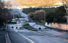 Protesting Imizamo Yethu residents protested on Monday 3 July and say they are angry at the slow pace of rebuilding the community after the blaze in March which claimed 4 lives. Picture: Shamiela Fisher/EWN.