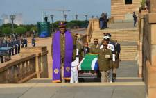 The body of former president Nelson Mandela arrived at the Union Buildings in Pretoria after a procession from 1 Military Hospital on 11 December 2013. Picture: SAPA.