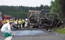 Eighteen people were killed when a tour bus burst into flames after colliding with a lorry on a motorway in the German state of Bavaria. Picture: AFP
