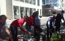 Staff at Townhouse Hotel using excess shower water for gardening. Picture: Supplied.
