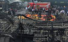 Indonesian forensic policemen work after a fire disaster in Tangerang Kota, Banten province on October 26, 2017. Picture: AFP