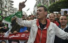 Algerians take part in a demonstration against ailing President Abdelaziz Bouteflika in the capital Algiers on 22 March 2019. Bouteflika said on 22 February he would run for a fifth term in 18 April elections, despite concerns about his ability to rule. Picture: AFP