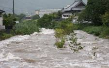 Rising water caused by heavy rain is seen at Muromi river in Fukuoka on 28 August 2019. Picture: AFP