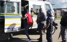 More than 200 Sasolburg residents arrested during riots this week and are accused of theft will remain behind bars. Picture: Sebabatso Mosamo/EWN