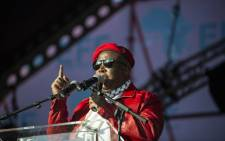 Julius Malema, Commander in Chief of the South African political party Economic Freedom fighters (EFF), addresses a crowd of about 3,000 EFF supporters gathered during a rally to mark the partys first anniversary in Thokoza Park in Soweto on 26 July 2014. Picture: AFP.