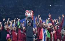 Liverpool's German coach Jurgen Klopp (C) raises the European Champion Clubs' Cup as he celebrates with players their victory after the UEFA Champions League final football match between Liverpool and Tottenham Hotspur at the Wanda Metropolitano Stadium in Madrid on 1 June, 2019. Picture: AFP.
