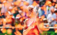 Johanna Konta holds the Butch Buchholz Trophy after her match against Caroline Wozniacki in the women's final at the Miami Open. Picture: Twitter/@MiamiOpen.