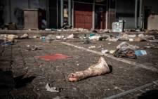 A pork trotter lies among other debris after looting at a Gauteng shopping centre. Picture: Abigail Javier/Eyewitness News