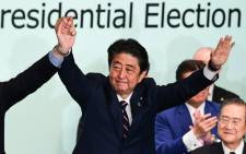 Japan's Prime Minister Shinzo Abe celebrates after the ruling liberal Democratic Party (LDP) leadership election at the party's headquarters in Tokyo on 20 September 2018. Picture: AFP.