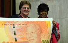 SA Reserve Bank governor Gill Marcus and Winnie Madikizela-Mandela at the launch of the Mandela currency on 5 September 2012. Picture: Werner Beukes/SAPA