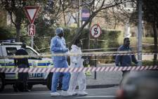 Forensic pathologists arrive on the scene of the shooting in Rosebank. Baker Street has been closed off. Picture: Sethembiso Zulu/EWN