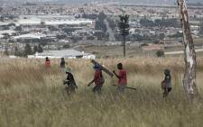 FILE: A group of people attempt to illegally occupy land in Rabie Ridge, Midrand on 15 April 2019.. Picture: Sethembiso Zulu/Eyewitness News.