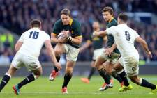 FILE: Springbok captain Jean de Villiers pieces through England players during their match on 15 November 2014. Picture: Springbok Official Facebook page.