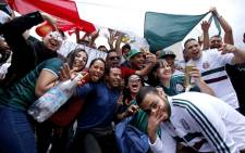 FILE: Mexican fans gather to celebrate Mexico's victory against Germany during the 2018 World Cup, in Guadalajara, Jalisco state, Mexico on 17 June 2018. Picture: AFP