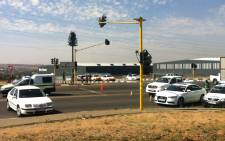Police cars patrol the scene where gun battle between taxi operators was reported on the corner of Old Pretoria and Allandale Roads on 8 October 2014. Picture: Christa Eybers/EWN.