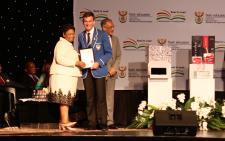 Basic Education Minister Angie Motshekga congratulates top achiever Andrew Tucker.  Picture: Christa Eybers/EWN