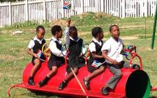 Muzomuhle Primary children play on their new playground equipment.