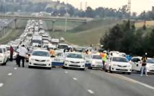 Taxi operators block the N1 North at the N17 on 18 November 2020 as they make their way to the Union Buildings in Pretoria. Picture: @JoburgMPD/Twitter