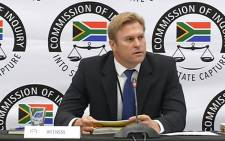 A screengrab shows Gerhard van der Westhuizen at the state capture commission of inquiry on 27 May 2019.