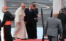 Pope Francis is welcomed by Cuban President Raul Castro (C) upon landing at Jose Marti international airport in Havana on 19 September, 2015. Picture: AFP.