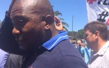 A screengrab of Democratic Alliance leader Mmusi Maimane being chased away by University of Cape Town students on 20 October 2015.
