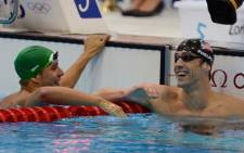 FILE: Runner-up Chad Le Clos (L) and winner Micahel Phelps after they swam in the men's 100-metre butterfly final on 3 August, 2012, at the London Olympic Games. Picture: Wessel Oosthuizen/SA Sports Picture Agency.