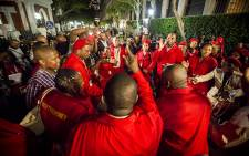 Julius Malema and other EFF members dance and sing at parliament after they were thrown out of the State of the Nation Address 2015. Picture: Thomas Holder/EWN