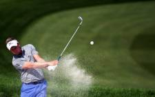 FILE: Luke Donald of England hits out of the bunker at the second hole during the WGC-HSBC Champions Golf tournament in Shanghai on 7 November, 2014. Picture: AFP.