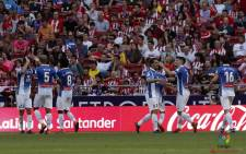 Espanyol players celebrate beating Atletico Madrid during their La Liga game on 6 May. Picture: @RCDEspanyol/Twitter.