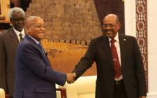 FILE: Sudanese President Omar al-Bashir (R) shakes hands with South African President Jacob Zuma during a meeting.Picture: AFP.