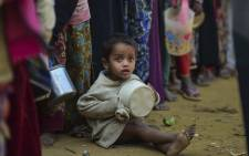 A Rohingya Muslim refugee waits with others for food aid at Thankhali refugee camp in Bangladesh's Ukhia district on 12 January 2018. Picture: AFP