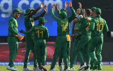 South African players celebrate after the dismissal of Australia's captain Aaron Finch (not pictured) during the ICC men's Twenty20 World Cup cricket match between Australia and South Africa at the Sheikh Zayed Cricket Stadium in Abu Dhabi on 23 October 2021. Picture: INDRANIL MUKHERJEE/AFP