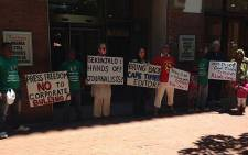 Demonstrators affiliated to the R2K Campaign gather outside Newspaper House to protest the axing of Cape Times editor Alide Dasnois. Picture: Giovanna Gerbi/EWN.
