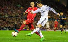 Real Madrid's Cristiano Ronaldo outruns Liverpool's Martin Skrtel and takes a shot during the Champions League Group B match at Anfield which Madrid won 3-0. Picture: Official Liverpool Facebook page.
