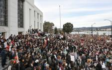 Protesters congregate at the Alameda County Court House during a 'Millions March' demonstration protesting the killing of unarmed black men by police on 13 December 2014 in Oakland, California. Picture: AFP.
