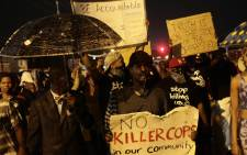 Demonstrators protest Michael Brown's murder August 16, 2014 in Ferguson, Missouri. Picture: AFP.