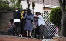 Family and friends can be seen arriving at the home of HHP. The rapper passed away earlier on Wednesday. Picture: Kayleen Morgan/EWN.