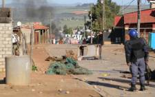 Riot police were deployed to Ilingelethu informal settlement on the outskirts of Malmesbury on Friday 6 June 2014 after violence broke out during a protest. Picture: Aletta Gardner/EWN