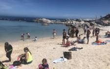 FILE: Beachgoers at Camps Bay Beach on 16 December 2020.. Picture: @LirandzuThemba/Twitter