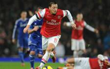 Arsenal's Mesut Ozil controls the ball during the Barclays Premiership match against Chelsea on 23 December 2013. Picture: Facebook.