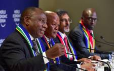Deputy President Cyril Ramaphosa, flanked by Ministers Rob Davies, Jeff Radebe, Ebrahim Patel and Malusi Gigaba, addresses a media conference at the end of his engagements at the World Economic Forum 2018 annual meeting in Davos, Switzerland. Picture: GCIS.