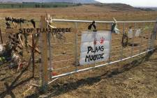 Signs at a farm in Normandien, Newcastle, in KwaZulu-Natal where Glen and Vida Rafferty were killed in August. Picture: Nkosikhona Duma/EWN