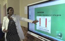 Protea Glen Secondary School teacher Sweetness Radebe uses a smartboard during her Life Sciences lesson. Picture: Vumani Mkhize/EWN.