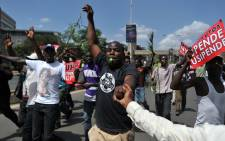 Opposition supporters demonstrate along the streets of the Kenyan capital Nairobi on 6 October 2017 to demand a change of guard at Kenya's national election oversight body. Picture:  AFP