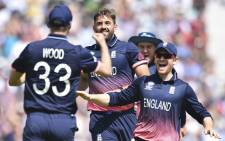 England players celebrate the fall of a wicket during an ICC Champions Trophy match. Picture: AFP