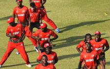 Kenyan cricketers warm up prior to practice session at the Gaddafi Cricket stadium in Lahore on 10 December, 2014. Picture: AFP.