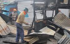 Residents of Mandela Park rebuild their homes following a shack fire. Picture: Georgina Selander/EWN